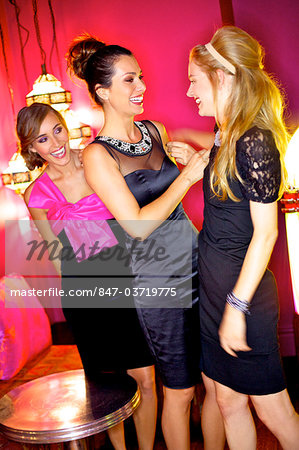 Three beautiful women having fun in a bar Stock Photo - Rights-Managed, Image code: 847-03719775