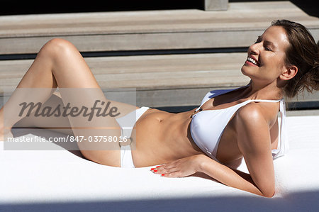 Landscape of a beautiful lady lying down in villa wearing bikini Stock Photo - Rights-Managed, Image code: 847-03758016