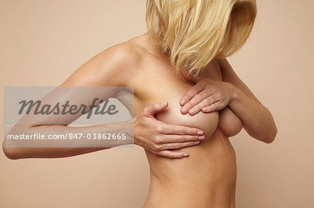 Beautiful nude mature blonde woman holding her body Stock Photo - Rights-Managed, Image code: 847-03862665