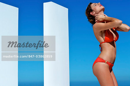Beautiful brunette on the beach Stock Photo - Rights-Managed, Image code: 847-03862859