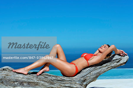 Beautiful brunette lying on the beach Stock Photo - Rights-Managed, Image code: 847-03862867