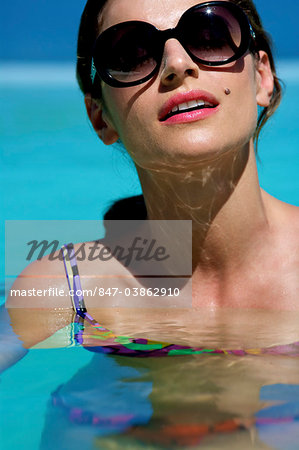 Beautiful brunette swimming in pool Stock Photo - Rights-Managed, Image code: 847-03862910