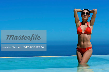 Beautiful brunette in swimming pool Stock Photo - Rights-Managed, Image code: 847-03862924