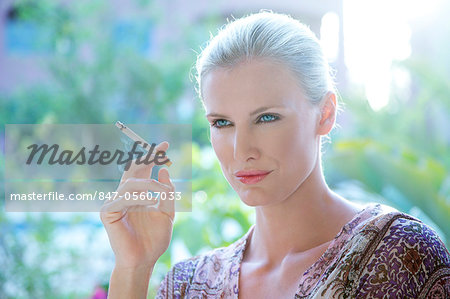 Landscape image of a woman smoking a cigarette Stock Photo - Rights-Managed, Image code: 847-05607033