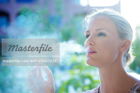 Landscape image of a woman smoking a cigarette Stock Photo - Rights-Managed, Image code: 847-05607034