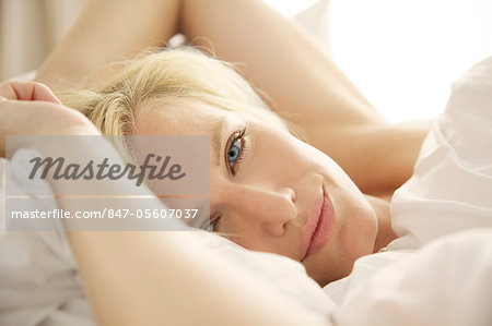 Portrait of a blonde woman waking up in bed Stock Photo - Rights-Managed, Image code: 847-05607037