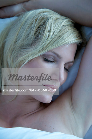 Portrait of a blonde woman asleep in bed Stock Photo - Rights-Managed, Image code: 847-05607038