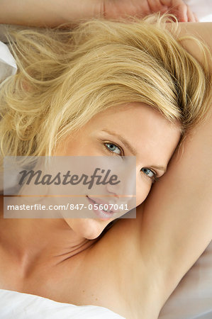 Portrait of a blonde woman waking up in bed Stock Photo - Rights-Managed, Image code: 847-05607041