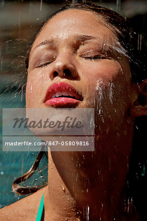 Beautiful girl in pool with water splashing on her face Stock Photo - Rights-Managed, Image code: 847-05809816