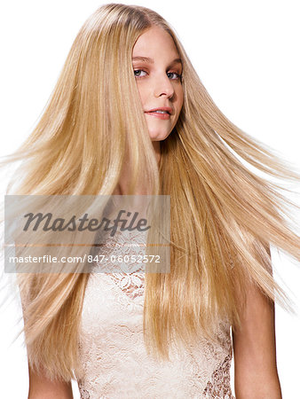 Beautiful blonde girl shaking her hair Stock Photo - Rights-Managed, Image code: 847-06052572
