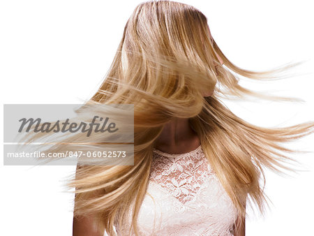 Beautiful blonde girl shaking her hair Stock Photo - Rights-Managed, Image code: 847-06052573