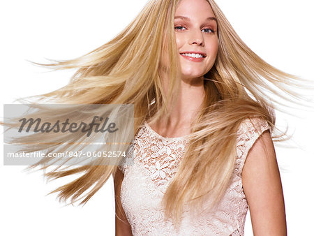 Beautiful blonde girl shaking her hair Stock Photo - Rights-Managed, Image code: 847-06052574
