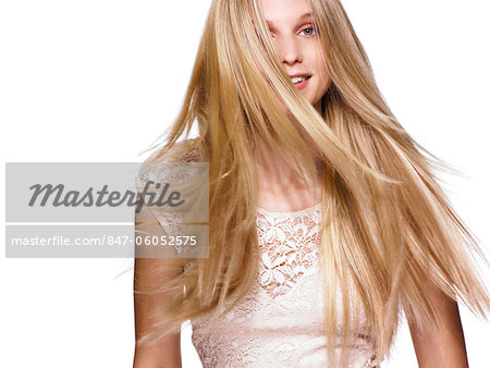 Beautiful blonde girl shaking her hair Stock Photo - Rights-Managed, Image code: 847-06052575