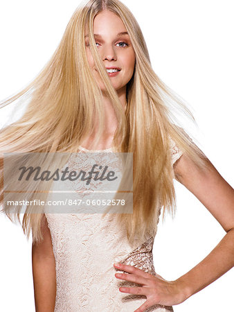 Beautiful blonde girl shaking her hair Stock Photo - Rights-Managed, Image code: 847-06052578
