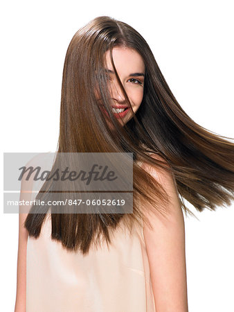 Beautiful brunette shaking her hair Stock Photo - Rights-Managed, Image code: 847-06052619