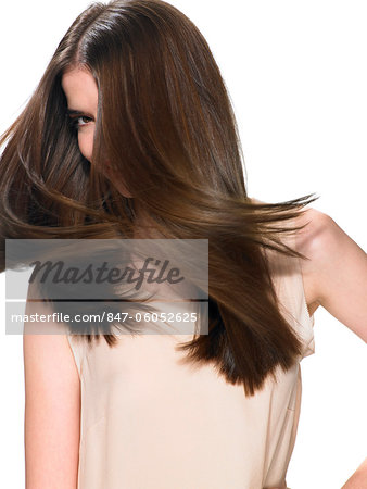 Beautiful brunette shaking her hair Stock Photo - Rights-Managed, Image code: 847-06052625