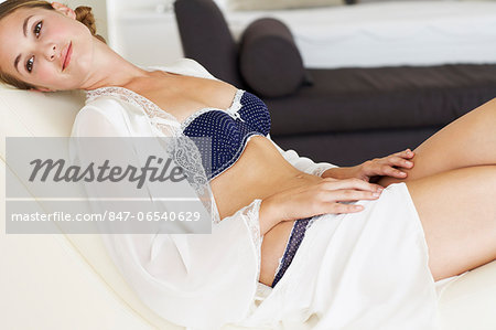 Beautiful young woman laying on chaise longue Stock Photo - Rights-Managed, Image code: 847-06540629