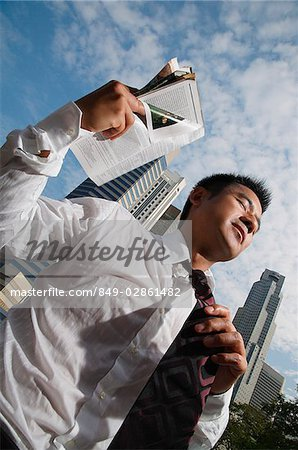 Businessman fanning himself with magazine Stock Photo - Rights-Managed, Image code: 849-02861482
