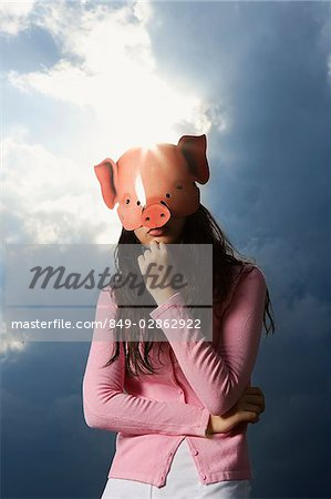 lady wearing pig mask Stock Photo - Rights-Managed, Image code: 849-02862922