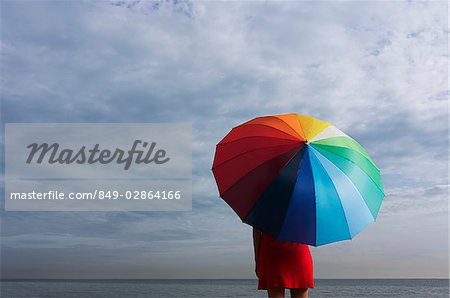 Legs of young woman underneath big umbrella Stock Photo - Rights-Managed, Image code: 849-02864166