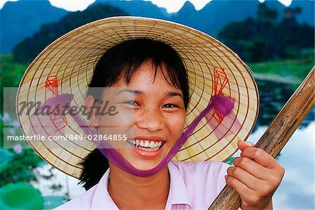 Vietnam, Perfume Pagoda, Hanoi, Vietnamese girl rowing a small boat Stock Photo - Rights-Managed, Image code: 849-02864855