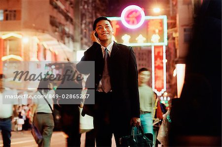 Hong Kong, male executive using cellular phone, carrying briefcase Stock Photo - Rights-Managed, Image code: 849-02865267