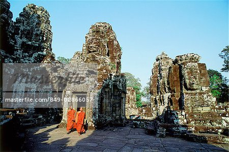 Cambodia, Angkor Thom, monks walking between face towers of the Bayon Stock Photo - Rights-Managed, Image code: 849-02866057