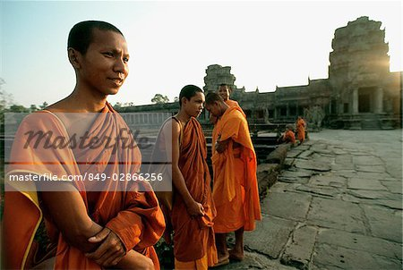 Cambodia, Angkor Wat, Young monks on stone path to temple Stock Photo - Rights-Managed, Image code: 849-02866256