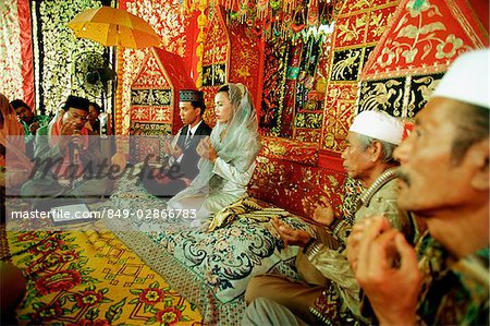 Indonesia, a Muslim cleric reading from the Koran to bind bride and groom in marriage. Stock Photo - Rights-Managed, Image code: 849-02866783