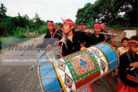 Indonesia, Lombok, drummers leading a wedding procession. Stock Photo - Rights-Managed, Image code: 849-02866790