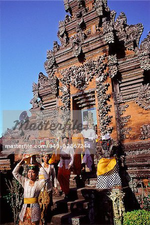 Indonesia, Bali, Hindu festival, People with offerings enter temple via candi bentar (split gates). Stock Photo - Rights-Managed, Image code: 849-02867244