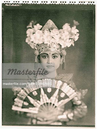 Indonesia, Bali, Amlapura, Legong dancer in full costume holding fan. Stock Photo - Rights-Managed, Image code: 849-02867601