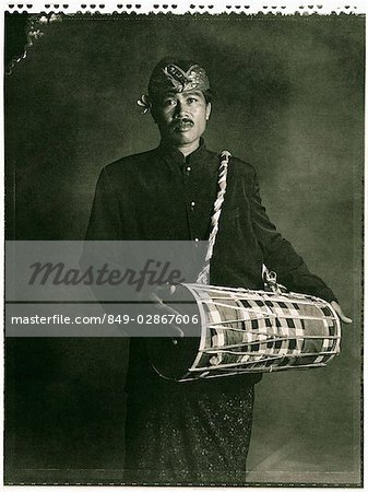 Indonesia, Bali, Amlapura, Gamelan player holding drum. Stock Photo - Rights-Managed, Image code: 849-02867606