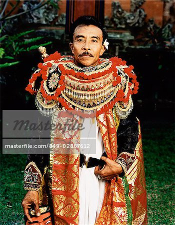 Indonesia, Bali, Ubud, Balinese mask dancer in costume in temple courtyard. Stock Photo - Rights-Managed, Image code: 849-02867612
