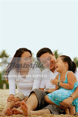 Family with one child, daughter laughing Stock Photo - Rights-Managed, Image code: 849-02871073