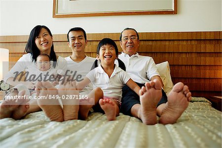 Three generation family on bed, looking at camera, low angle view Stock Photo - Rights-Managed, Image code: 849-02871165