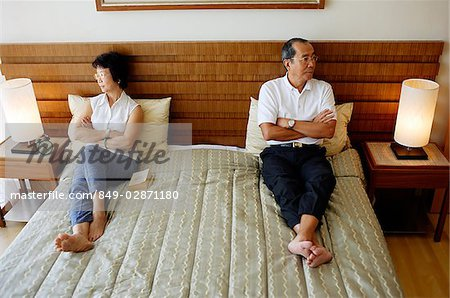 Older couple lying apart on bed, arms crossed Stock Photo - Rights-Managed, Image code: 849-02871180