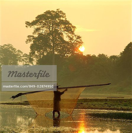 Cambodia, Sien Reap, Angkor Wat, Local woman carrying fishing net across river at dawn Stock Photo - Rights-Managed, Image code: 849-02874950
