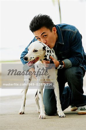 Man with Dalmatian dog, smiling at camera Stock Photo - Rights-Managed, Image code: 849-02875314