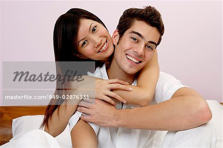 Couple embracing, looking at camera, portrait Stock Photo - Rights-Managed, Image code: 849-02876331