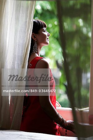 Indian woman looking out window Stock Photo - Rights-Managed, Image code: 849-03645472