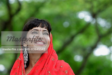 Head shot of Indian woman smiling with red sari over her head Stock Photo - Rights-Managed, Image code: 849-03645542