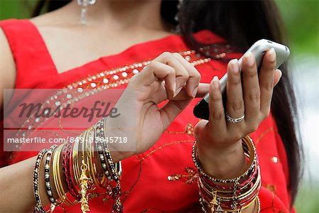 Close up of Indian woman texting on phone Stock Photo - Rights-Managed, Image code: 849-03645718