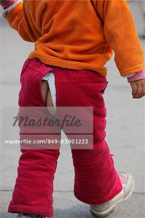 Young girl with bum exposed through split in pants Stock Photo - Rights-Managed, Image code: 849-03901223