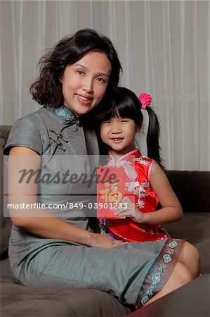 Mother holding daughter with red envelope (Hong Bao) Stock Photo - Rights-Managed, Image code: 849-03901233