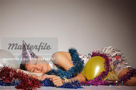 Woman asleep among party balloons and streamers Stock Photo - Rights-Managed, Image code: 849-06466097