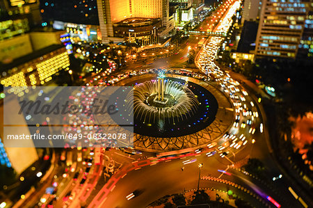 Indonesia, Jakarta, Hotel Indonesia roundabout, Welcome Monument and buildings along Jalan Thamrin at night Stock Photo - Rights-Managed, Image code: 849-08322078