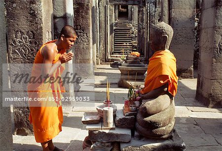 Monk praying in the Preah Khan Temple,Siem Reap,Cambodia Stock Photo - Rights-Managed, Image code: 851-02959033