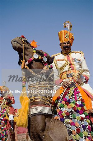 A soldier riding a camel at the Jaisalmer festival,Rajasthan,India Stock Photo - Rights-Managed, Image code: 851-02960461