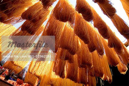 Safron dyed cloth hanging up to dry in souks of Marrakesh,Morocco Stock Photo - Rights-Managed, Image code: 851-02962155